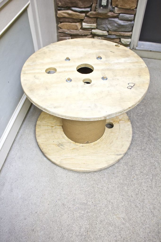 Wire Spool Table Plant Stand. The wire spool needs to be sanded before you can stain and paint it.