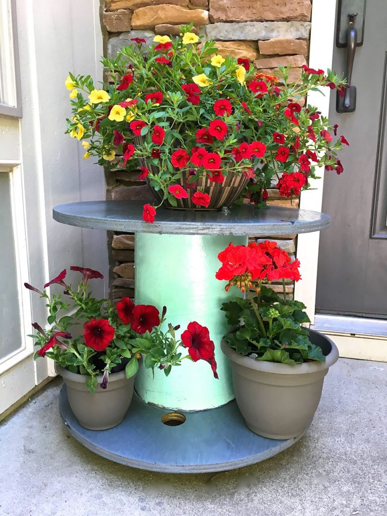 Wire Spool Table Plant Stand. Wire spool plant stand is perfect by the front door.