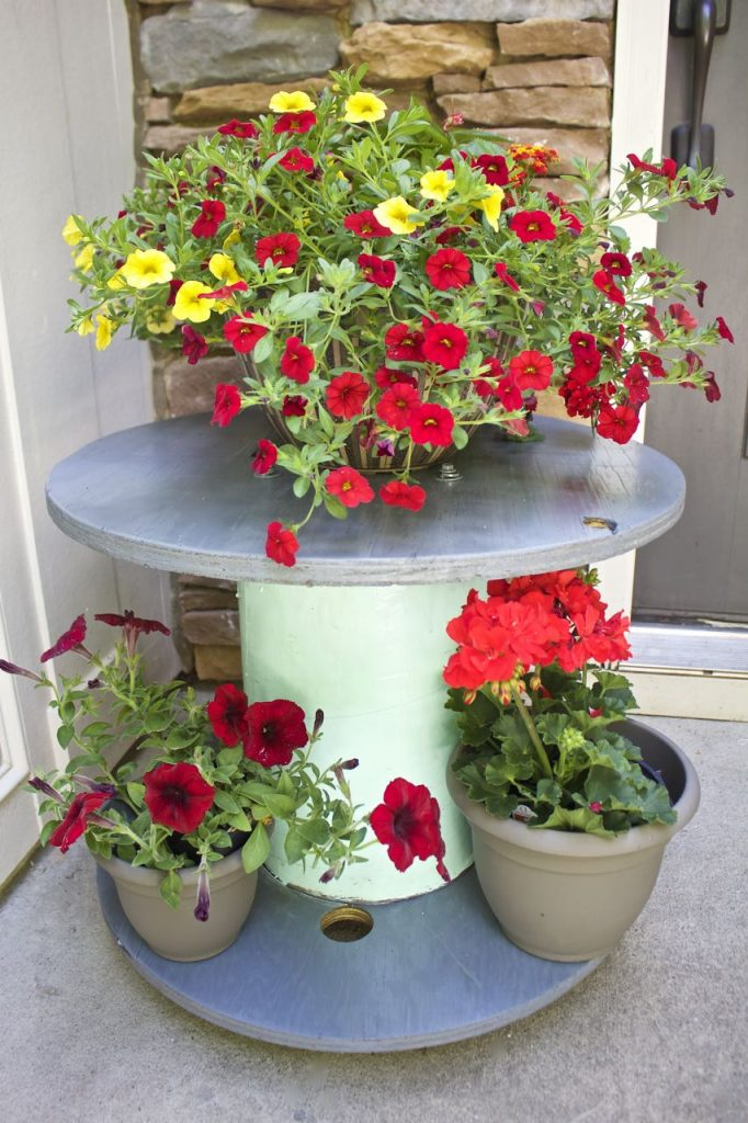Wire Spool Table Plant Stand. Wire spool table DIY makeover. DIY wire spool plant stand.