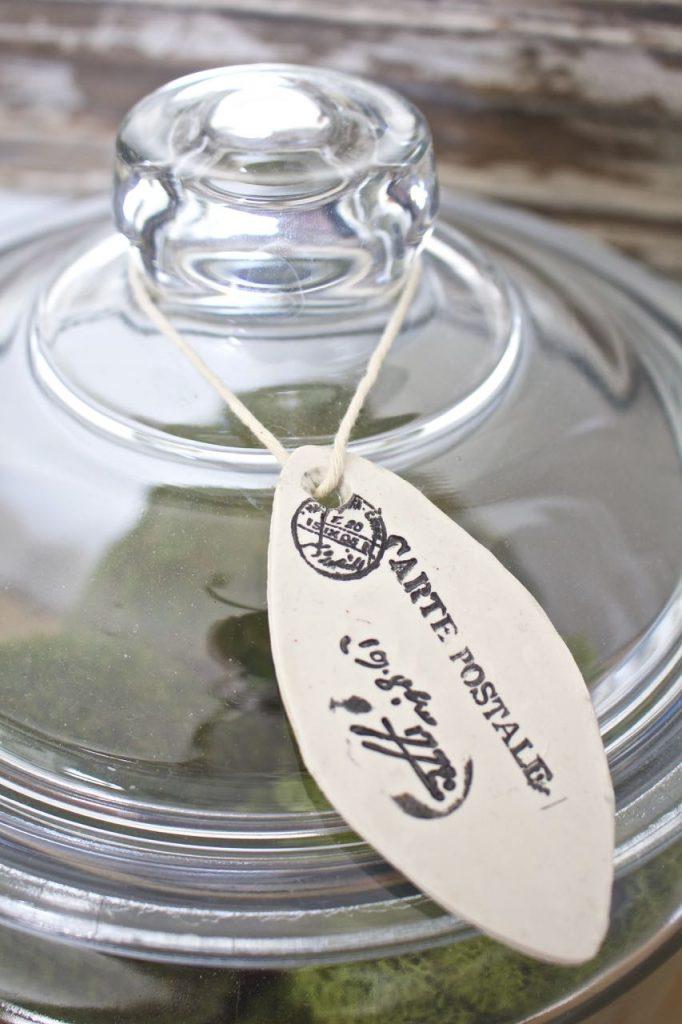 Entry Table Decor. French tag on an apothecary jar. Everett foyer table.