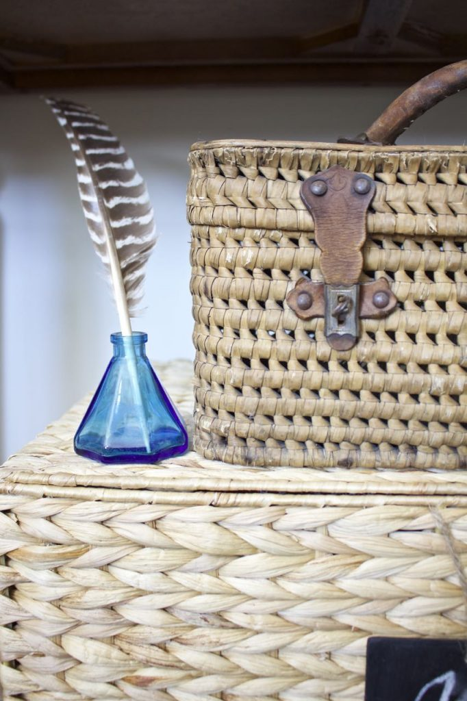 Entry Table Decor. Vintage French Basket and antique blue inkwell.