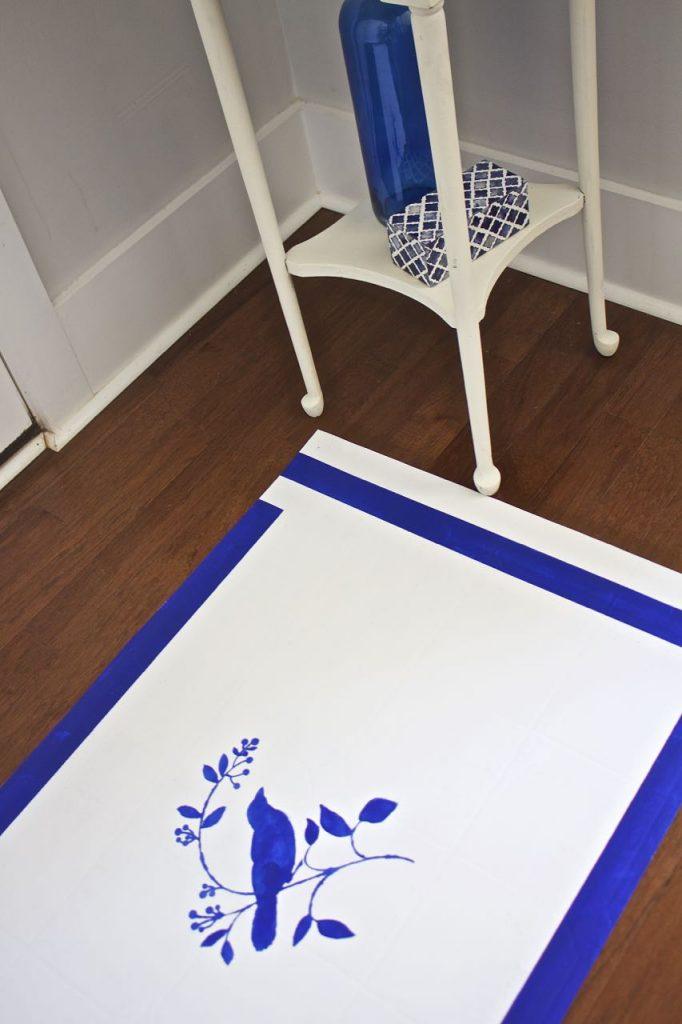 how to paint a rug using linoleum flooring. Painted Vinyl Floor Mat. DIY blue and white painted vinyl floor mat.