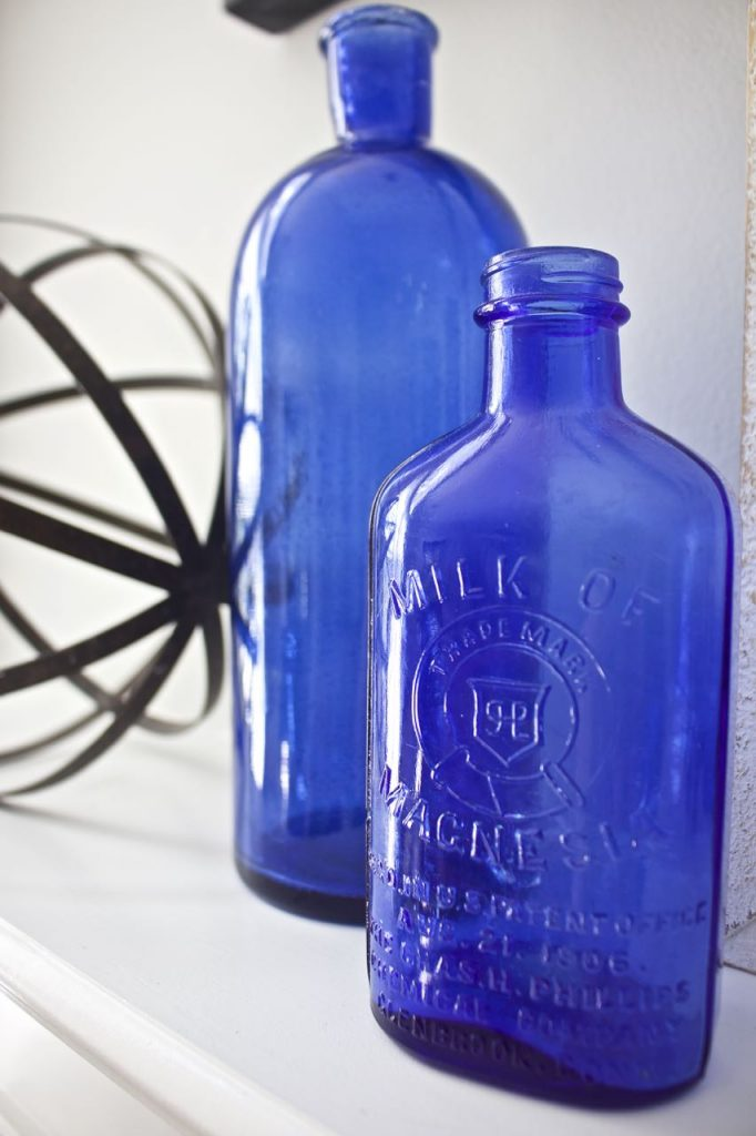 Summer Vintage Nautical Mantel. Cobalt Blue bottles.