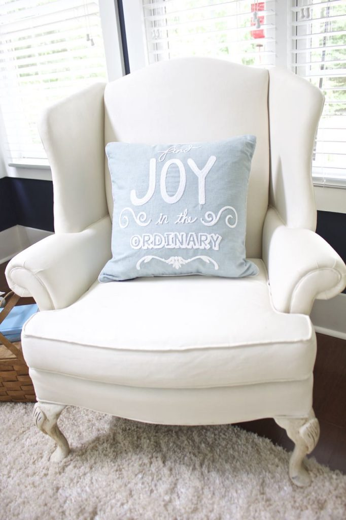 Sunroom decor for summer. Painted wing chair.