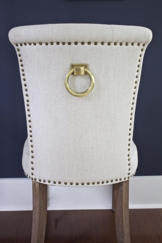 New Dining Room Chairs. Pretty brass rings on the back of the dining room chairs.