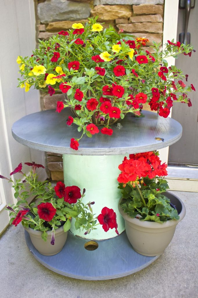 Summer garden and porch tour. Spool teable with fresh flowers.