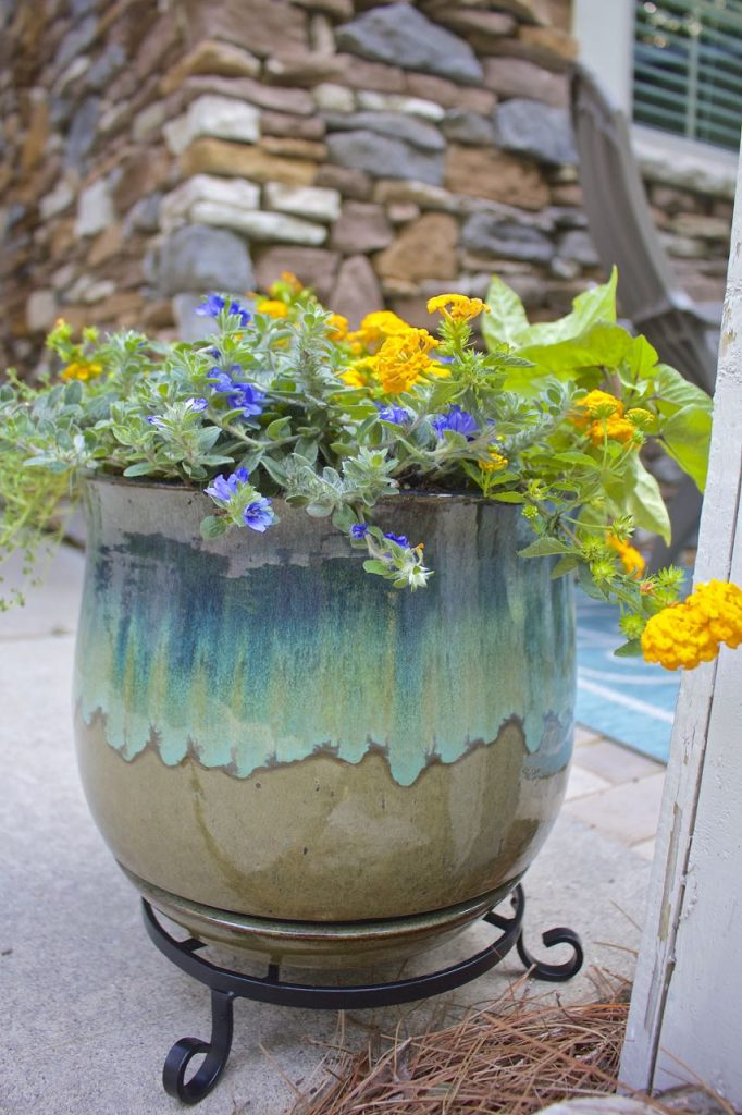 Summer garden and porch tour. Turquoise pottery on the front porch with lantana.