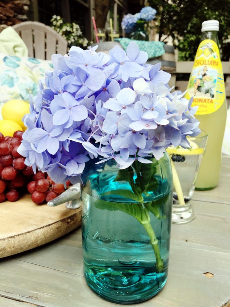 Summer garden and porch tour. Vintage aqua mason jar and hydrangeas