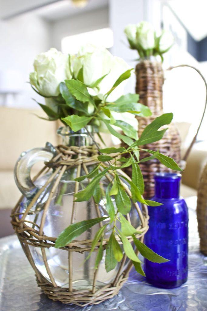 Wicker Demijohn Bottle. Thrifted bottles make for gorgeous home decor.