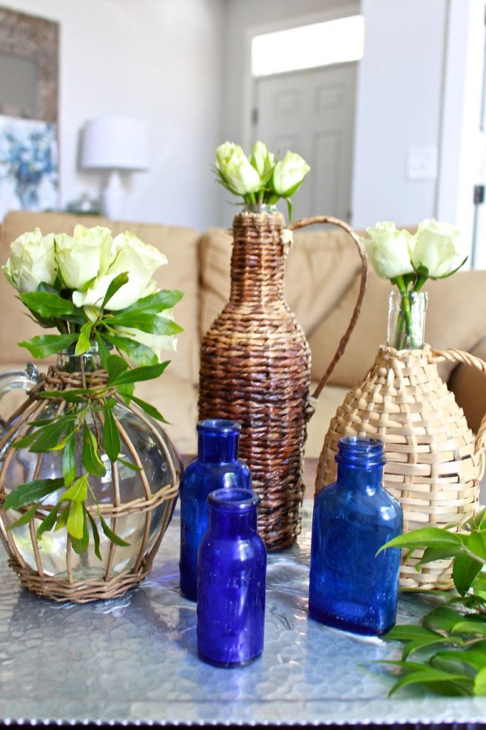 Wicker Demijohn Bottles. Thrift style is gorgeous.