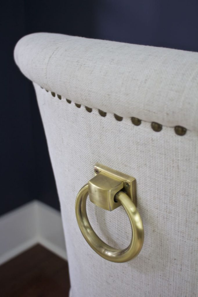 ew Dining Room Chairs. Jewelry onthe back of the dining room chairs - pretty brass ring and tacks.