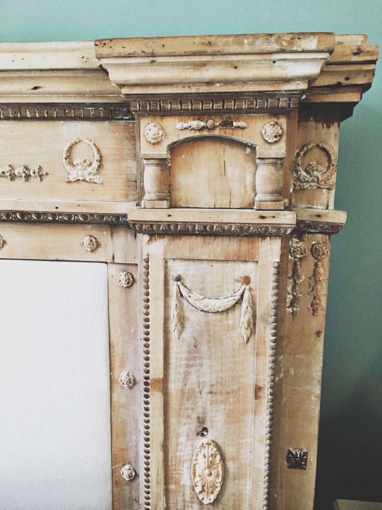 Fireplace mantel headboard has gorgeous details