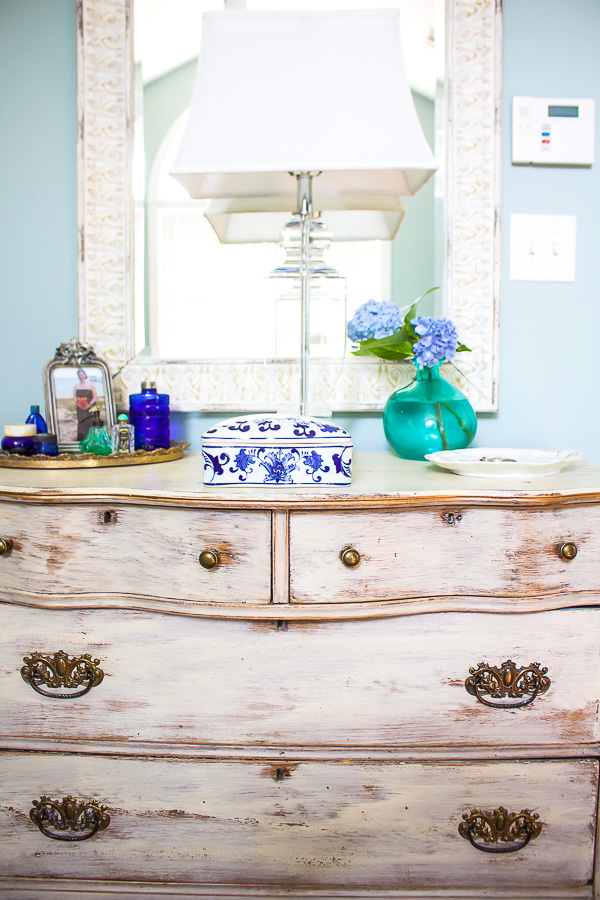antique dresser is paired with a new mirror