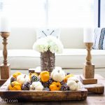 Easy Fall Centerpiece in Minutes. Just add pumpkins, pinecones and wood elements for a perfect fall centerpiece.