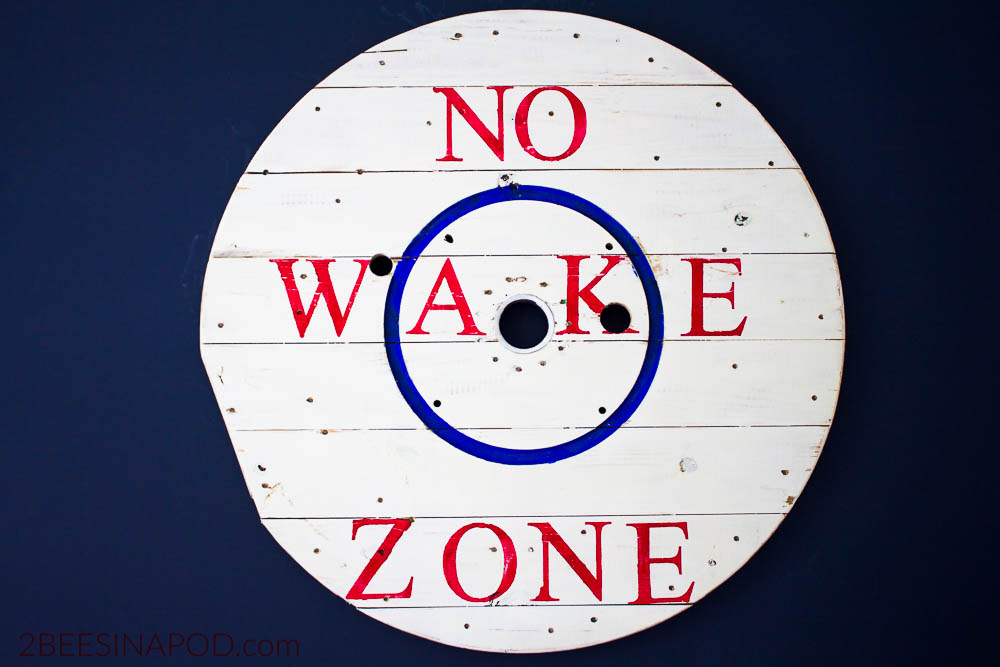 No Wake Zone Sign Made From Wire Spool. A lakehouse bedroom is a perfect spot for a no wake zone sign