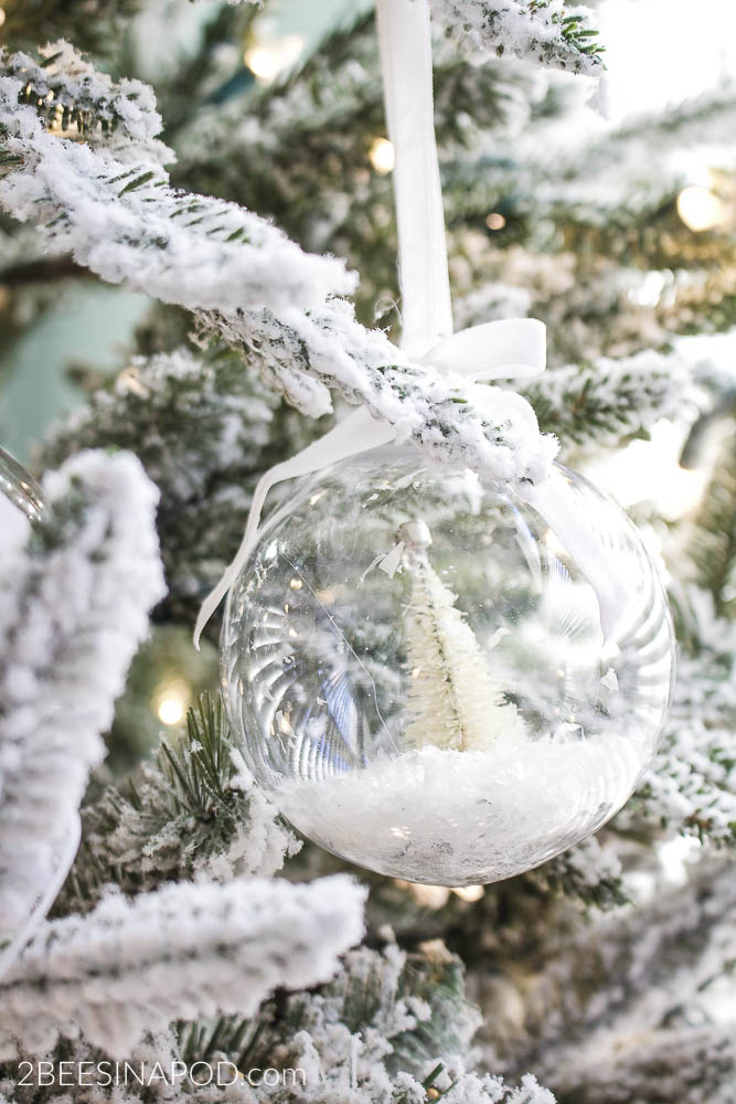the green color oozed off of the tree like paint and the tree turned mint green these diy bottlebrush christmas tree snow globe ornaments were created the