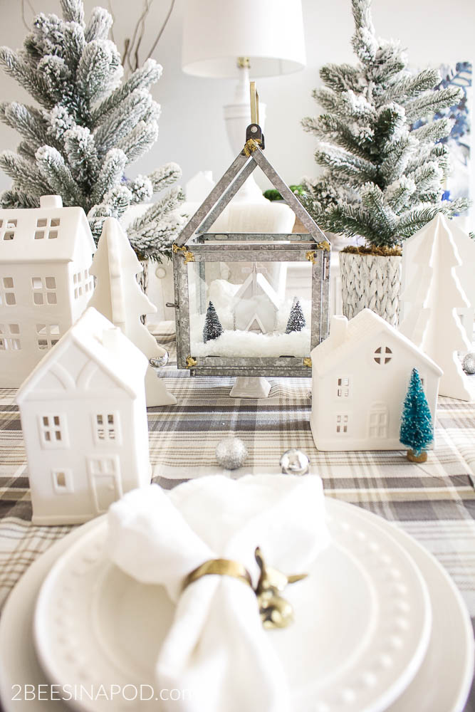 Christmas Village Tablescape with beautiful white houses and flocked trees