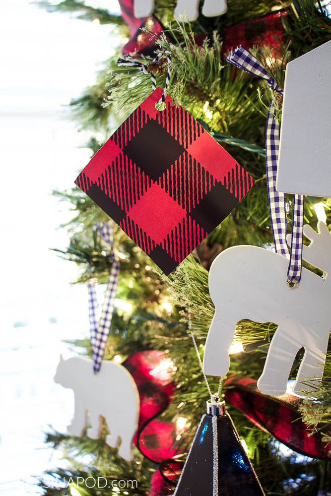 tip 5 use wrapping paper that coordinates with your tree and cut squares and use as ornaments