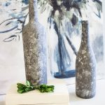 Faux Galvanized Painted Wine Bottles can be used as candleholders
