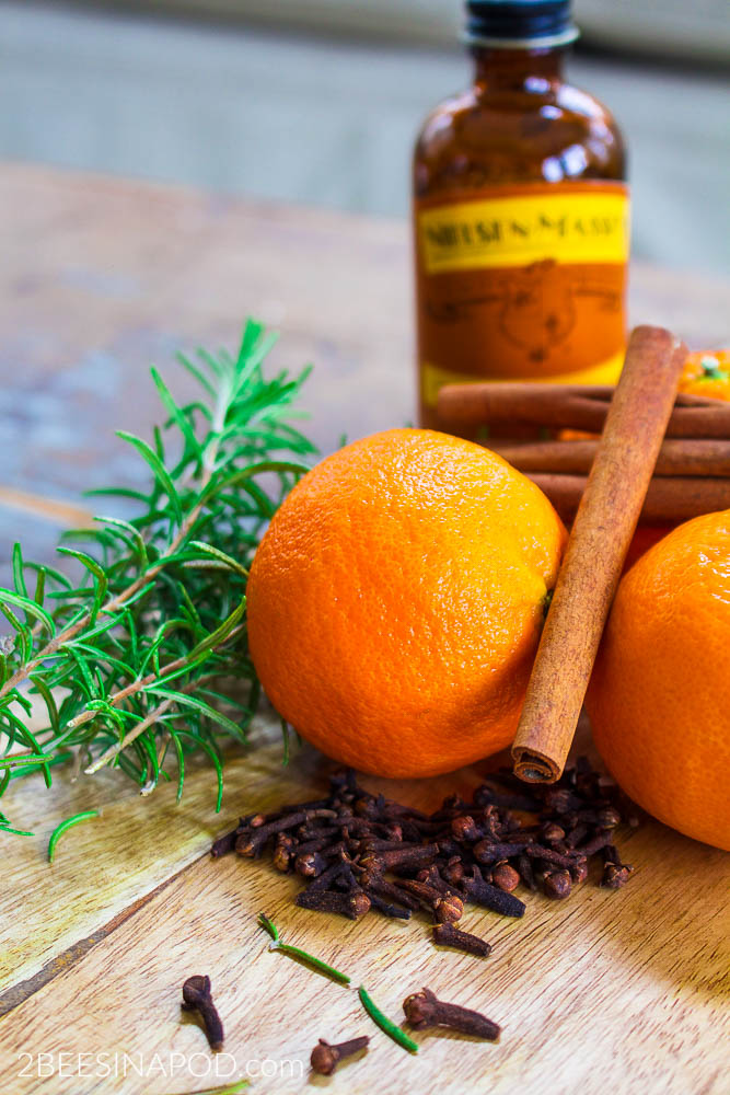 Rosemary and Citrus Orange Spice Simmer Pot - Banish Winter Funk. Fresh orange peels added to a pot of water with spices make a simmer pot.