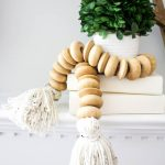 How to Make a Wood Bead Garland With Tassels. DIY wood bead garland with tassels.