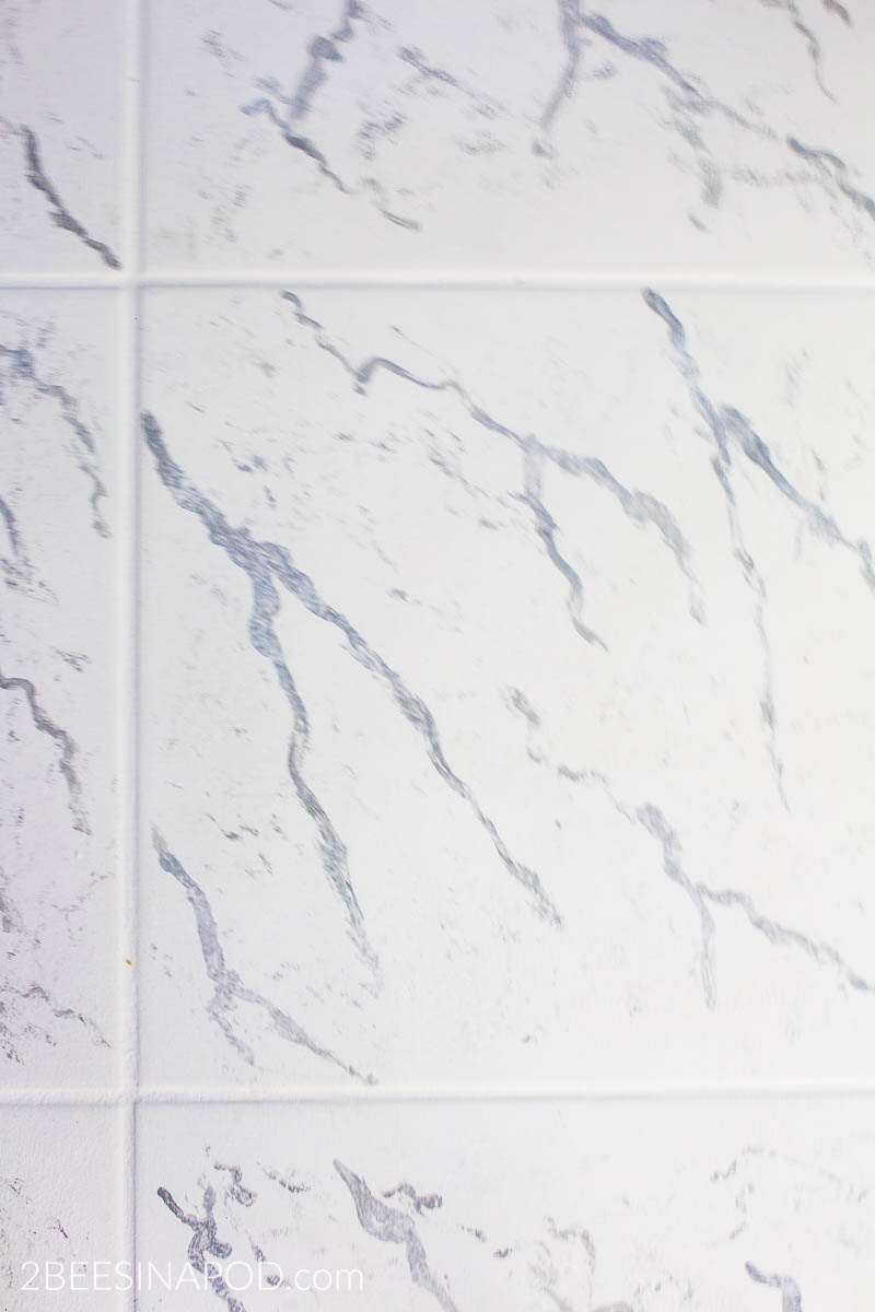 Blue and White Bathroom Makeover Reveal - One Room Challenge Week 6. Painted ceramic tile to look like marble
