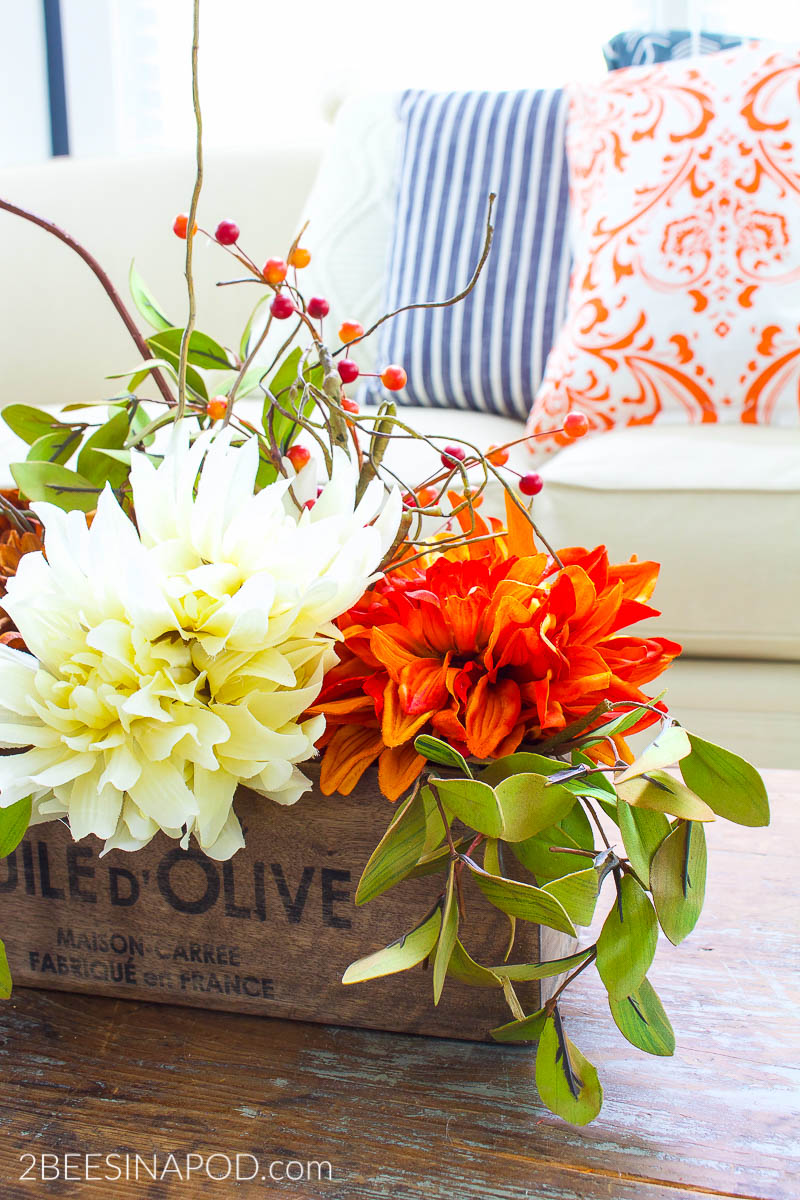 Easy Fall Centerpiece - silk flowers from the dollar store look so good