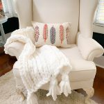 The handmade chunky throw looks perfect on the painted wing chair