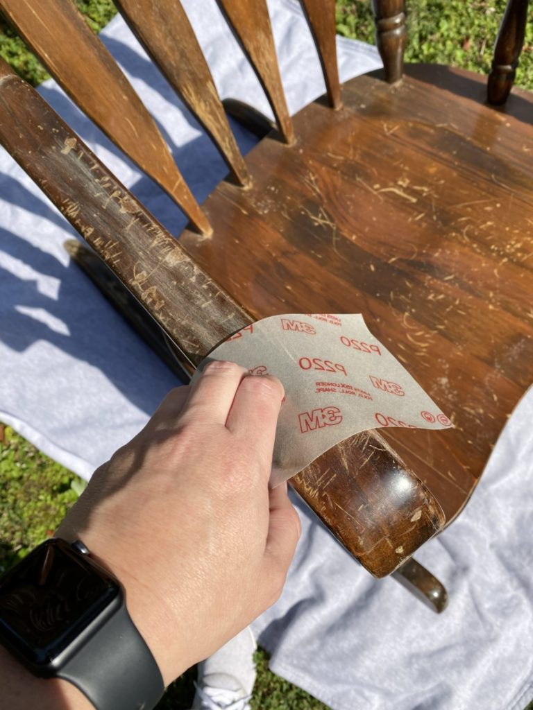 Sanding the chalk painted rocking chair