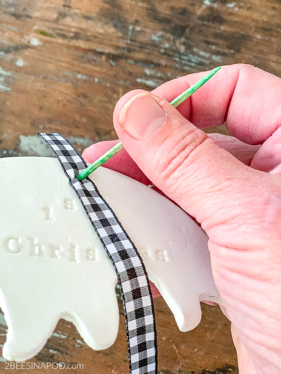 Air Dry Clay Christmas Ornaments - Using Cookie Cutters - use a toothpick to push ribbon through hole